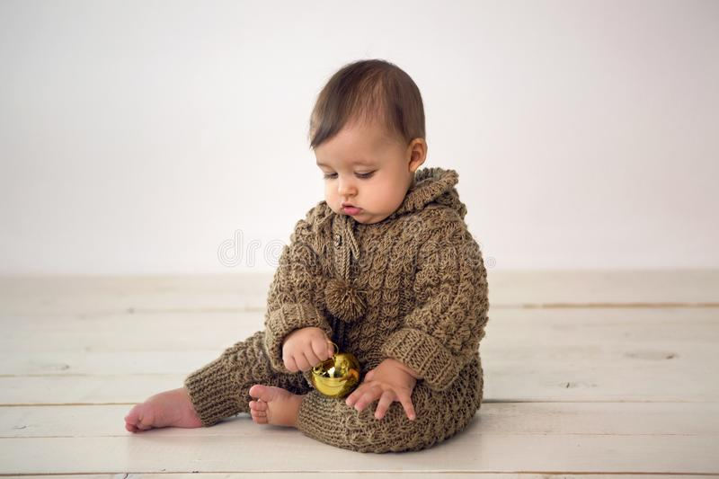 Baby boy crawling on the floor in knitted stock image