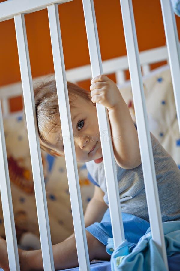 Baby Boy In A Crib. Adorable Baby Boy In A Crib stock photography