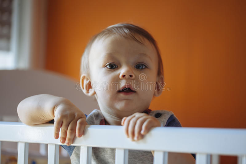 Baby Boy In A Crib. Baby Boy Standing In A Crib royalty free stock photo