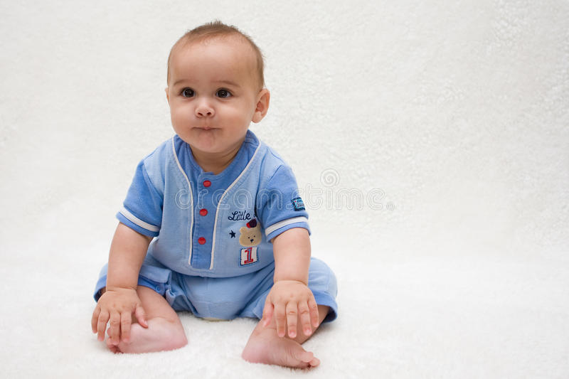 Baby boy with cute grin royalty free stock images