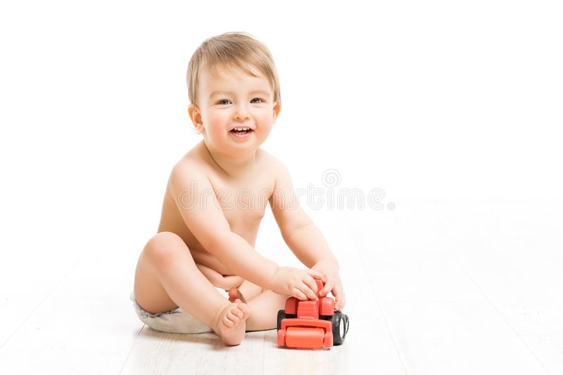 Baby Boy in Diaper Play Toy, Happy Infant Kid Playing Car, White royalty free stock photo