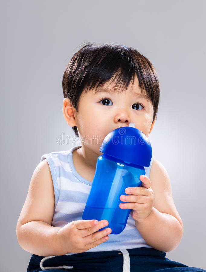 Baby boy drink water royalty free stock photos