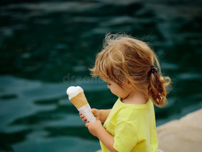 Baby boy eats icecream stock image