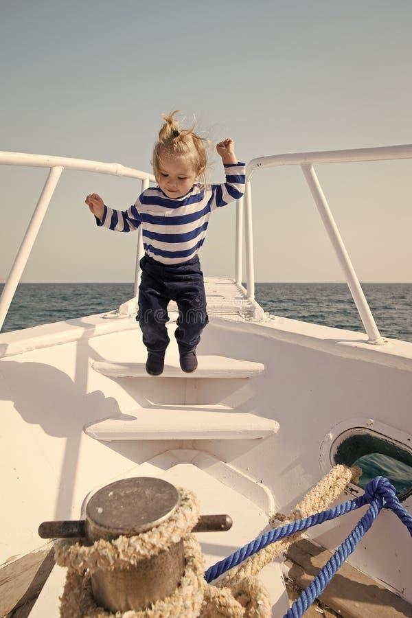 Baby boy enjoy vacation sea cruise ship. Child sailor. Boy sailor travelling sea. Boy sailor striped shirt sea yacht stock image