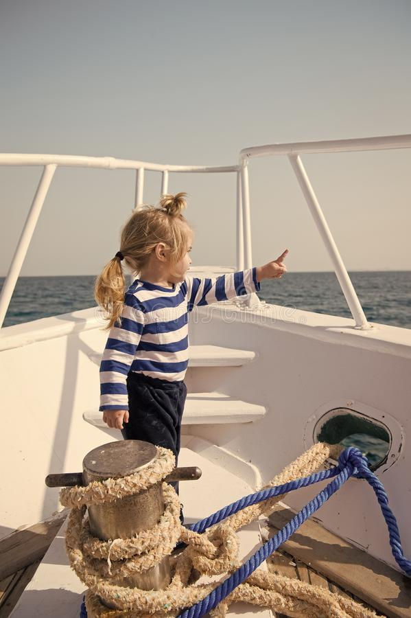 Baby boy enjoy vacation sea cruise ship. Child sailor. Boy sailor travelling sea. Boy sailor striped shirt sea yacht stock photo