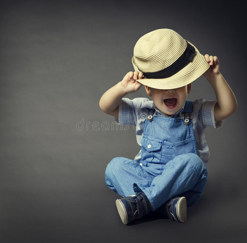 Baby Boy in Fashion Jeans, Hat Covered Eyes. Child Boy Beauty stock photos