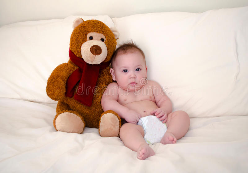 Baby boy and favorite teddy bear royalty free stock photography