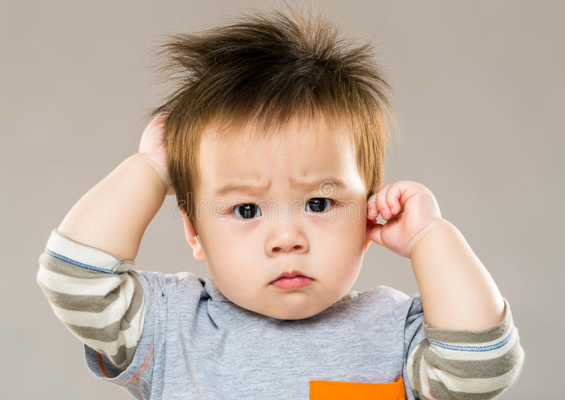Baby boy feeling confused stock images