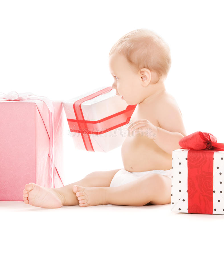 Baby boy with gifts stock images