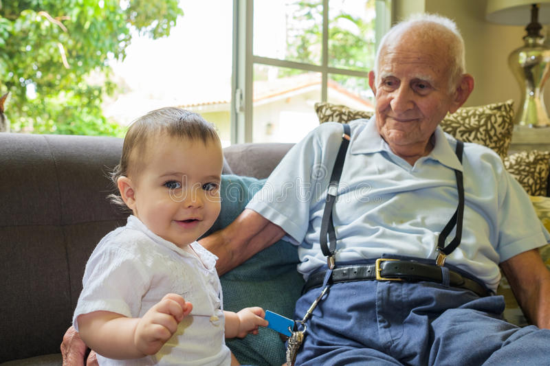 Baby boy with great grandfather stock photos