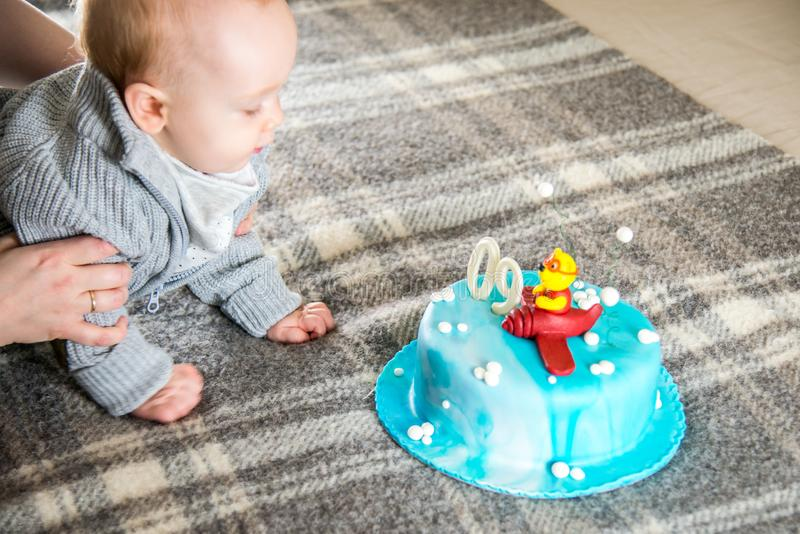 Baby boy having his nine month birthday royalty free stock photography