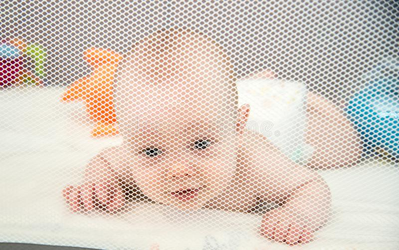 Baby boy in his safe place royalty free stock photography