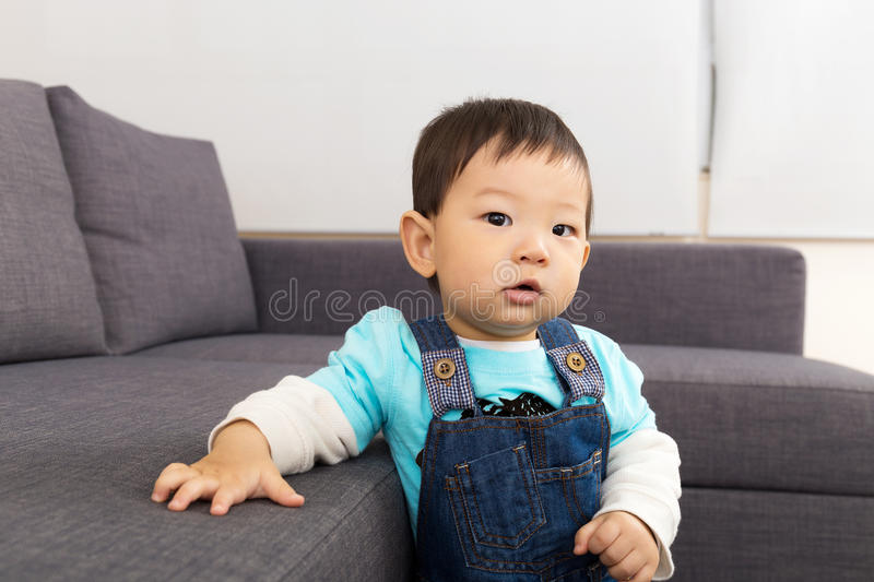 Baby boy at home stock image