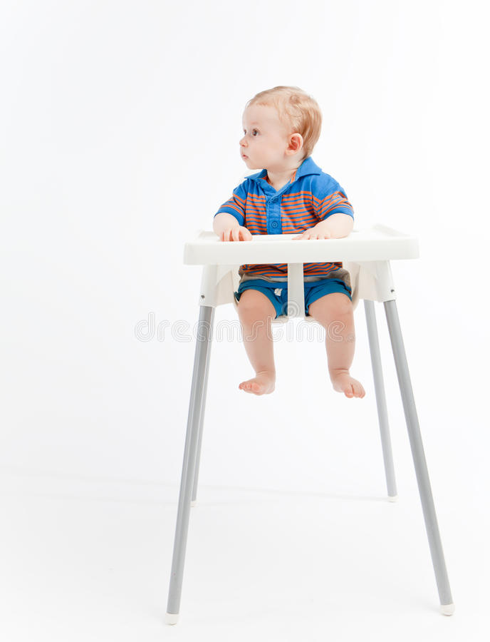 Free Baby Boy In High Chair, Looking Right Royalty Free Stock Photo - 28439115