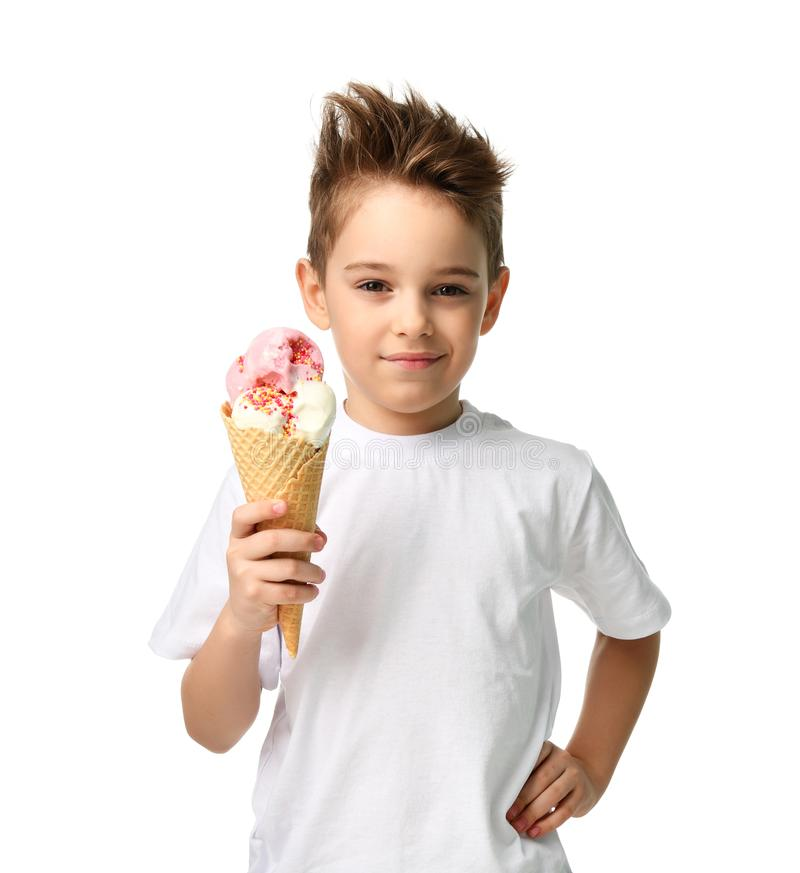 Baby boy kid hold strawberry ice cream in waffles cone isolated. On white background with free text copy space stock image
