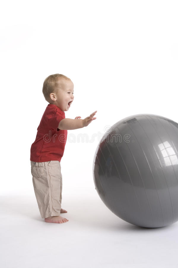 Baby boy with large ball