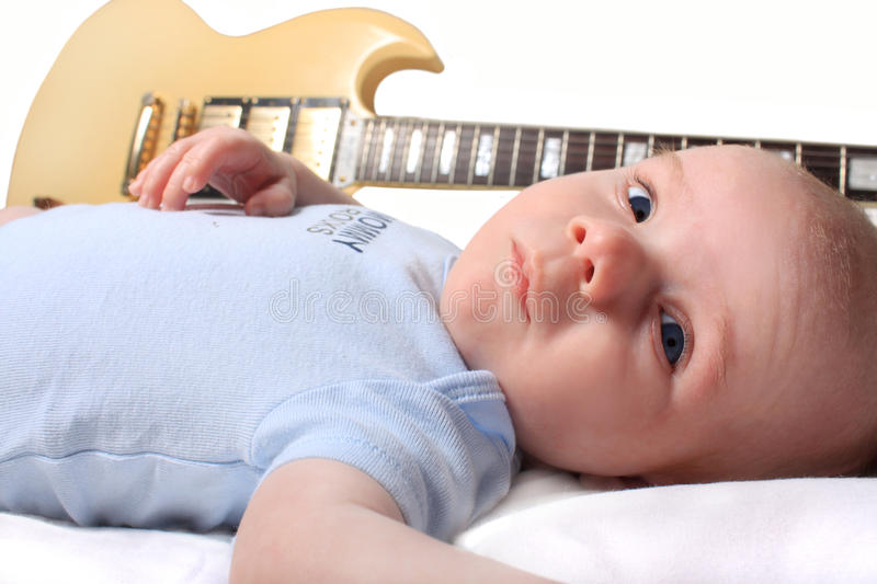 Baby Boy Laying With Guitar Royalty Free Stock Photo