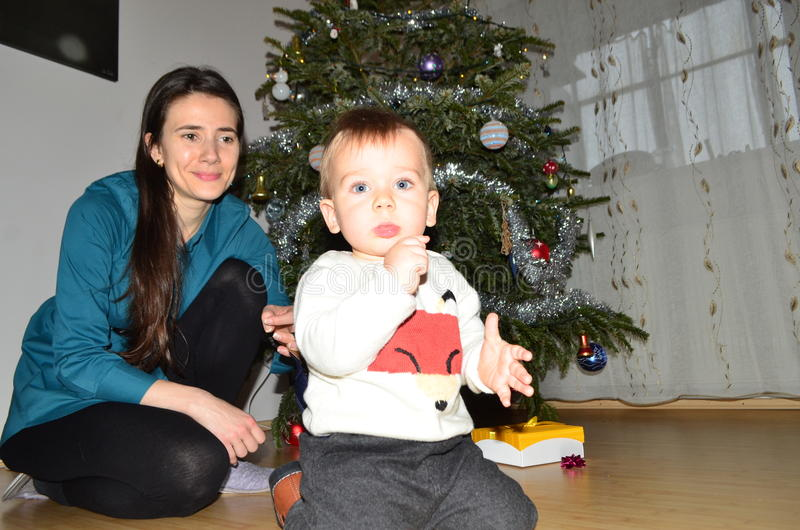 Baby boy and mother on Christmas day stock photography