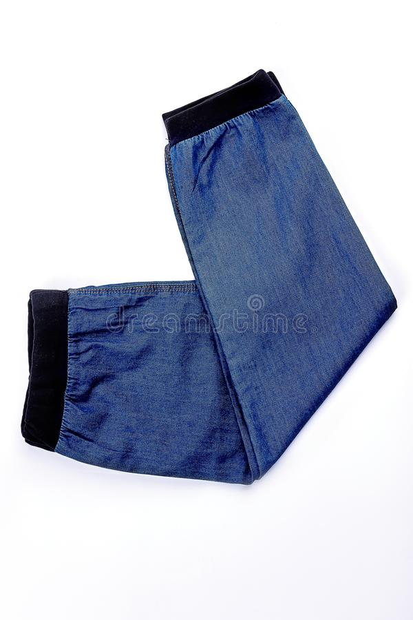 Baby-boy new folded jean trousers. Top view of fashionable jeans for little boys. High quality autumn kids apparel stock photo
