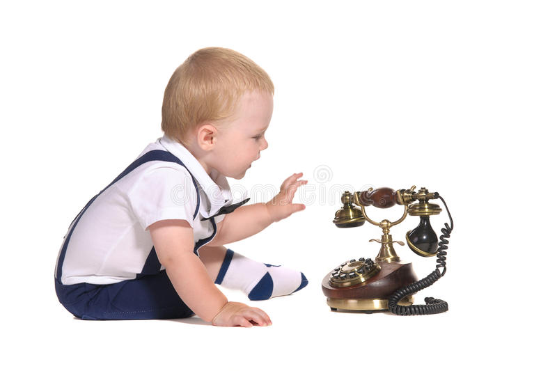 Baby boy with old-fashioned telephone royalty free stock photo