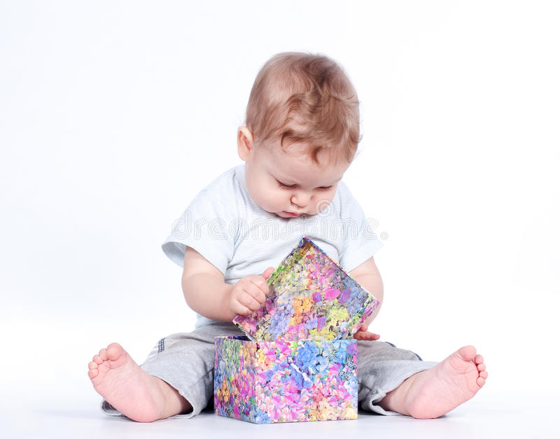 Baby boy opening gift box on white royalty free stock image
