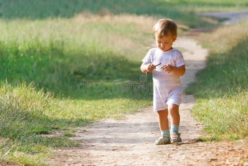 Baby Boy In Park Stock Photo