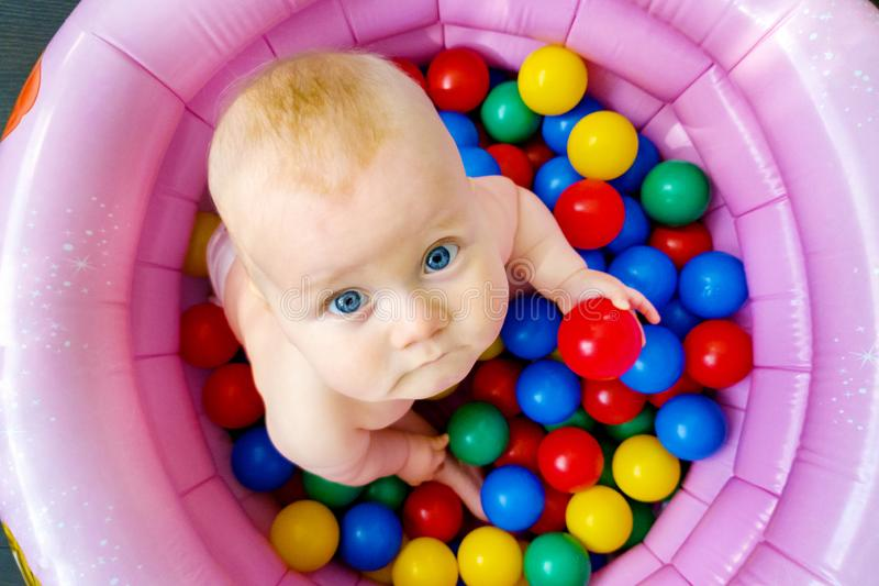 baby boy playing in ball pit stock photos