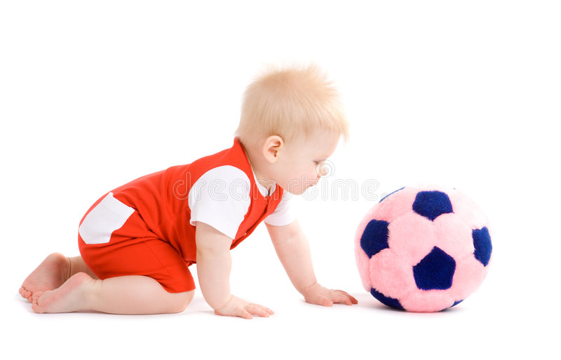 Baby boy playing football stock photography