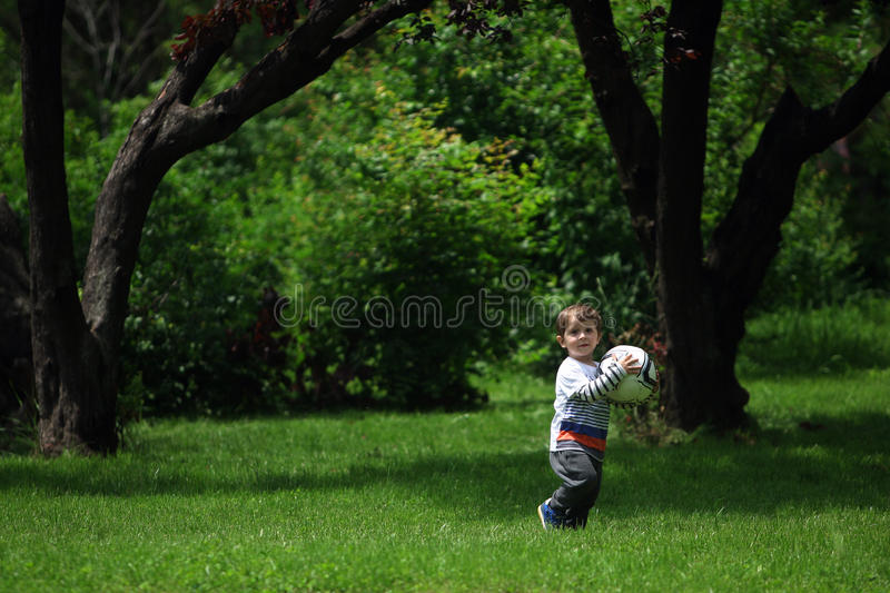 Baby Boy Playing Football Stock Photo