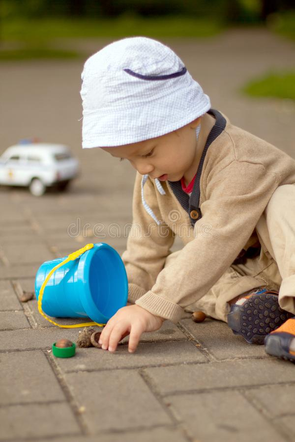 Baby Boy Playing on the Ground in The Park royalty free stock image