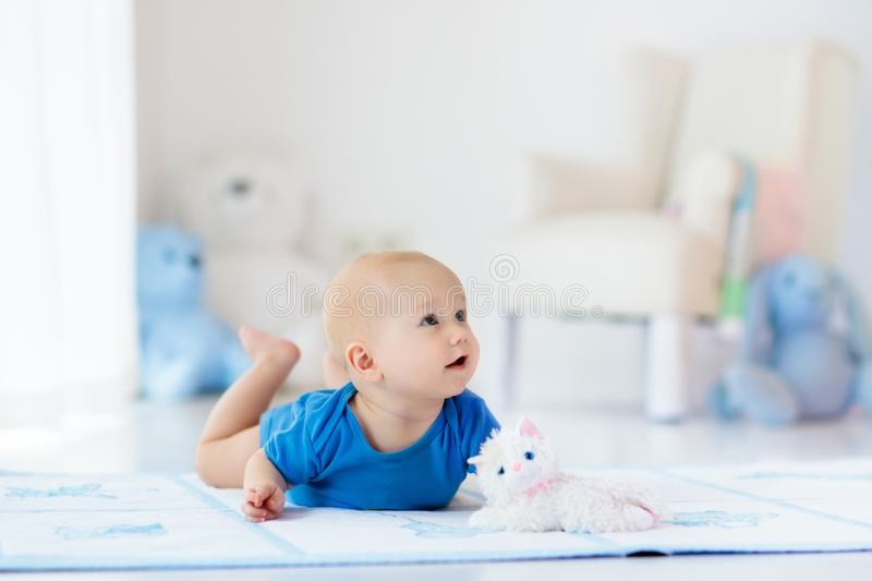 Baby boy playing and learning to crawl royalty free stock image