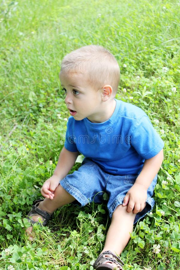 Baby boy playing outside stock images