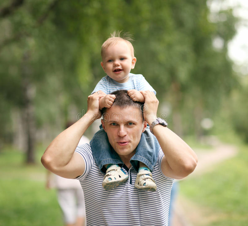 Baby boy playing in the park with dad royalty free stock images