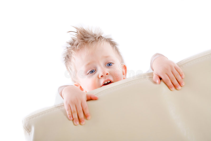 Baby boy playing peek a boo. 2 years old baby boy playing peek a boo at home stock photos