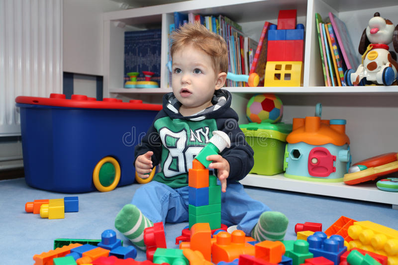 A baby boy playing with plastic blocks royalty free stock images