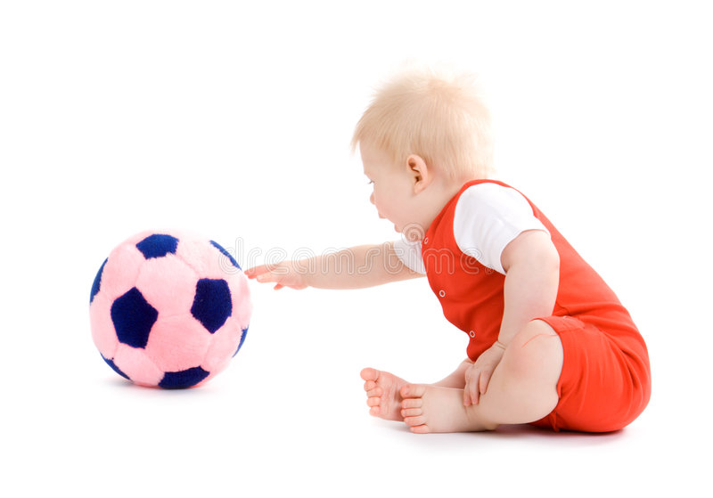 Baby boy playing soccer stock image
