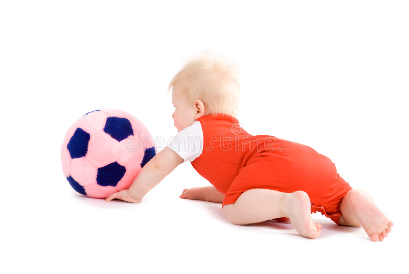Baby boy playing soccer royalty free stock image