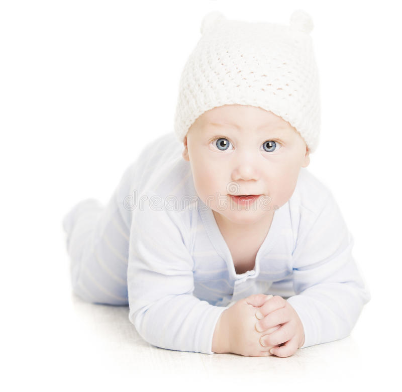 Baby Boy Portrait, Little Kid Crawling In Wolen Hat, Child Isolated Over White Background stock photo
