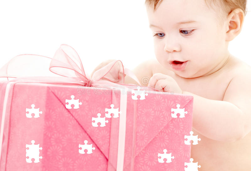 Baby boy with puzzle gift box. Puzzle picture of baby boy with big gift box stock photos