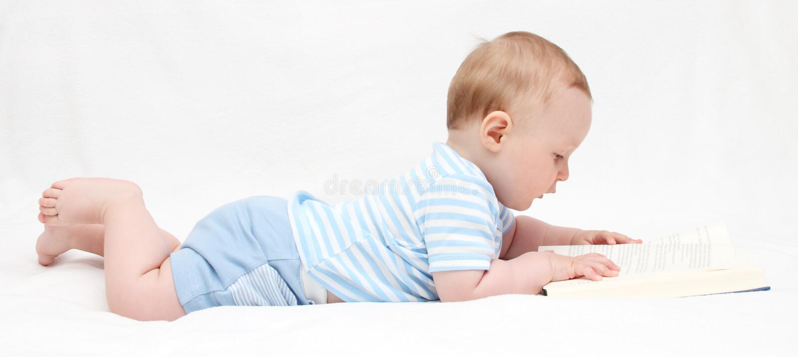 Baby boy reading a book child royalty free stock photo