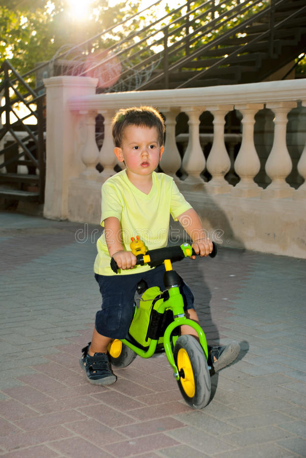 Baby Boy Riding On His First Bike Without Pedals Stock