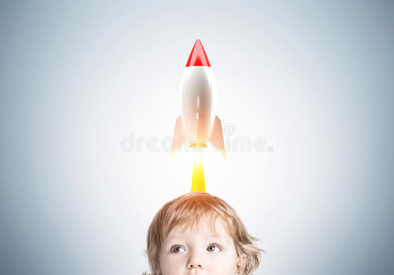 Baby boy and a rocket close up stock photo