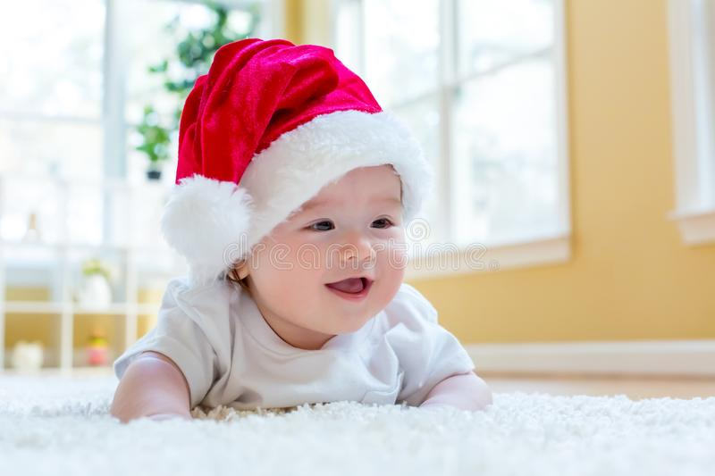 Baby boy with a Santa hat on Christmas royalty free stock image