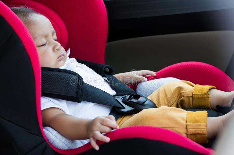 Baby boy sitting in a car seat . Safety chair royalty free stock images