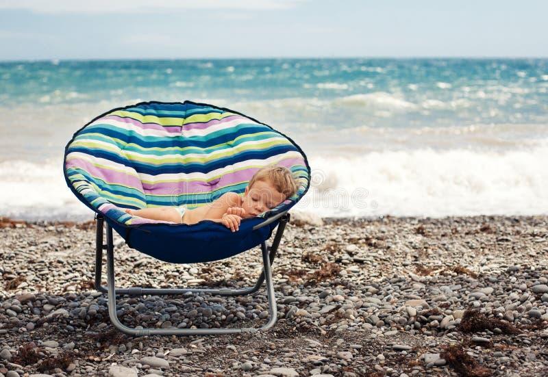 Baby boy sleeping on the beach royalty free stock photos