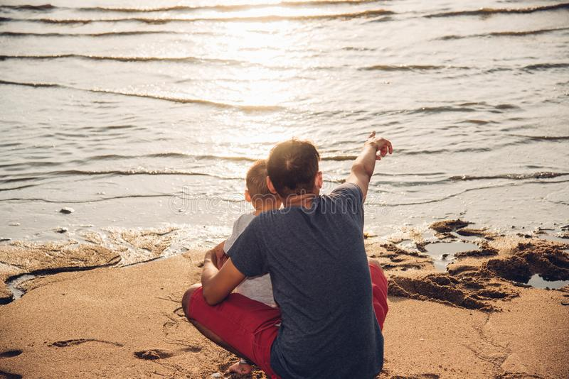 Baby boy son and father dad lifestyle happiness pointing to sea royalty free stock photography