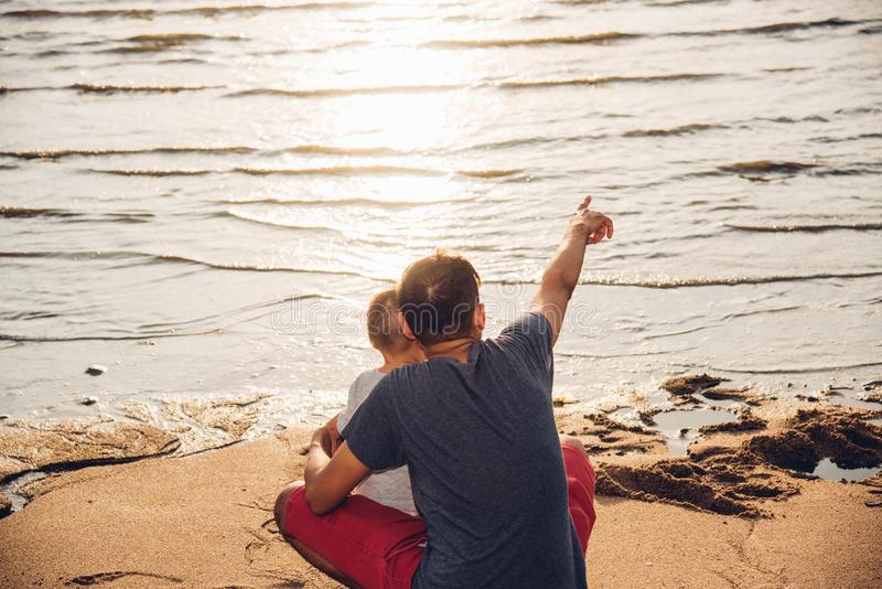 Baby boy son and father dad lifestyle happiness pointing to sea beach stock photos