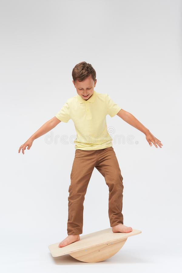 To keep the balance standing on the treadmill. training of the vestibular apparatus.balance exercise balancing. Baby boy stands on a special simulator for stock images
