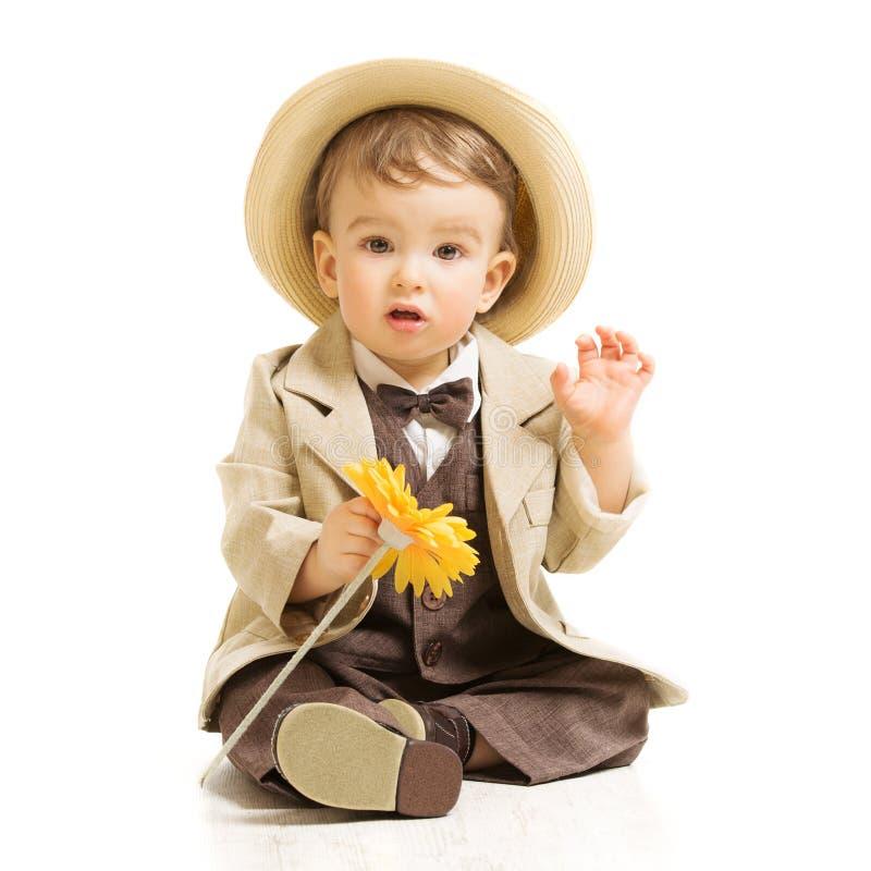 Baby boy in suit with flower. Vintage children. Baby boy well dressed in suit with flower. Vintage children style, white background stock photos
