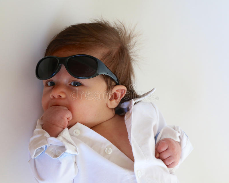 Baby Boy with Sunglasses. Baby boy with collared white shirt and sunglasses royalty free stock images